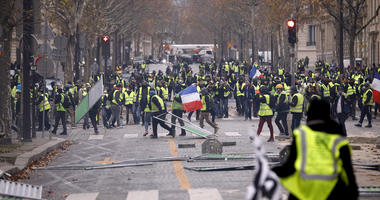 Demonstrators build a barricade near the Champs-Elysees avenue during a demonstration