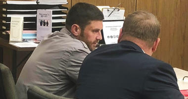 Track Palin, left, talks with his lawyer Patrick Bergt before a hearing in Anchorage, Alaska.