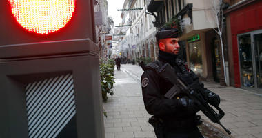 French police officer stands guard following a shooting in the city of Strasbourg
