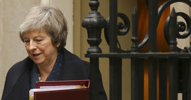 Britain's Prime Minister Theresa May leaves 10 Downing Street to attend the weekly Prime Ministers' Questions session, at parliament in London, Wednesday, Dec. 12, 2018