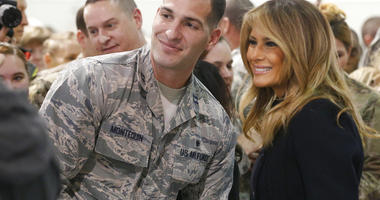 First lady Melania Trump , right, poses with an airman during a tour of Joint Base Langley in Hampton, Va., Wednesday, Dec. 12, 2018.