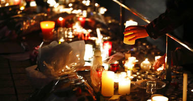 People place candles to pay respects to the victims the night following an attack that killed three persons and wounding at least 13, in Strasbourg, eastern France, Wednesday, Dec. 12, 2018.