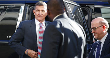 President Donald Trump's former National Security Advisor Michael Flynn arrives at federal court in Washington, Tuesday, Dec. 18, 2018