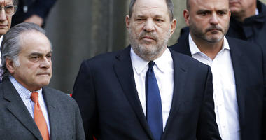 Harvey Weinstein, center, leaves New York Supreme Court with his attorney Benjamin Brafman, left, in New York.