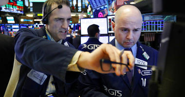 Trader Gregory Rowe, left, and specialist Mario Picone work on the floor of the New York Stock Exchange, Thursday, Dec. 27, 2018.