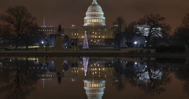 The Capitol is mirrored in the Reflecting Pool in Washington