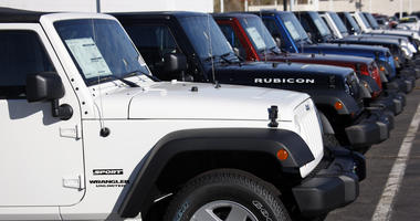 Wranglers sit at a Chrysler/Jeep dealership
