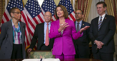 Speaker of the House Nancy Pelosi, D-Calif., talks to reporters after signing a House-passed a bill requiring that all government workers receive retroactive pay after the partial shutdown ends, at the Capitol in Washington