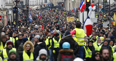 Yellow vest protesters demonstrate peacefully in the streets of Paris, France