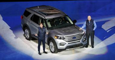 Ford Motor Co., President, Global Markets Jim Farley, left, and President and CEO Jim Hackett stand next to the redesigned 2020 Ford Explorer during its unveiling, in Detroit.