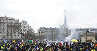 Yellow vest protesters march Saturday, Jan. 19, 2019 in Paris.