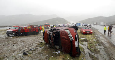 An overturned vehicle is seen at a scene of a fatal accident, where a volunteer member of the Ventura County search and rescue team was killed, along Interstate Highway 5 south of Pyramid Lake, Calif. Saturday, Feb. 2, 2019