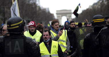 Yellow vest protesters walk down the famed Champs Elysees avenue to keep pressure on French President Emmanuel Macron's government