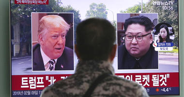 a man watches a TV screen showing images of U.S. President Donald Trump, left, and North Korean leader Kim Jong Un during a news program at the Seoul Railway Station in Seoul, South Korea