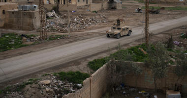 A Humvee drives in a village recently retaken from Islamic State militants by U.S.-backed Syrian Democratic Forces (SDF) near Baghouz, Syria, Sunday, Feb. 17, 2019