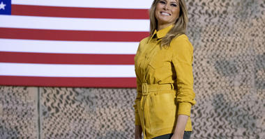 first lady Melania Trump smiles as she steps away from the podium after speaking alongside President Donald Trump at a hangar rally at Al Asad Air Base, Iraq, Wednesday, Dec. 26, 2018