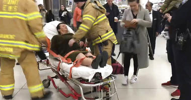 WNBC-TV News 4 New York, emergency medical personnel tend to an injured passenger from a Turkish Airlines flight at New York's John F. Kennedy International Airport,