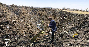 Ethiopian Airlines Facebook page, the CEO of Ethiopian Airlines, Tewolde Gebremariam, looks at the wreckage of the plane that crashed shortly after takeoff from Addis Ababa, Ethiopia