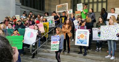 To chants of 'Hey Hey, Ho Ho, Climate Change Has Got to Go,' young people took over the steps of Pittsburgh's City-County Building for a Youth Climate Strike.