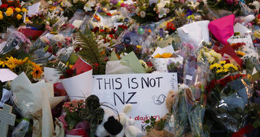 Mourners place flowers as they pay their respects at a makeshift memorial near the Masjid Al Noor mosque in Christchurch, New Zealand, Saturday, March 16, 2019