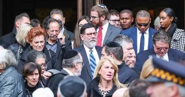 Pittsburgh Mayor Bill Peduto exits the memorial ceremony for brothers David and Cecil Rosenthal