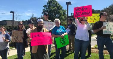 Ventura County residents gather in solidarity with local Muslims at the Islamic Center of Conejo Valley in Thousand Oaks Friday afternoon