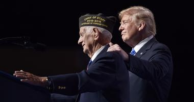 President Donald Trump honors World War II veteran Allen Q. Jones on Tuesday, July 24, 2018, by inviting the 94-year-old onto the stage at the VFW convention in Kansas City, Mo.'s Municipal Auditorium.