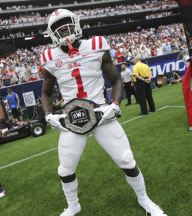 """Mississippi wide receiver A. J. Brown displays the team's """"Nasty Wide Outs"""" belt"""
