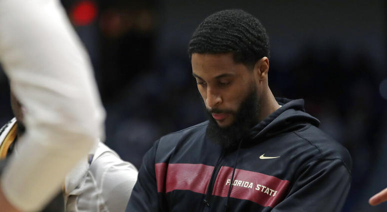 Florida State's Phil Cofer watches during a team huddle in the second half of a second round men's college basketball game against Murray State in the NCAA Tournament, Saturday, March 23, 2019, in Hartford, Conn. Florida State won 90-62