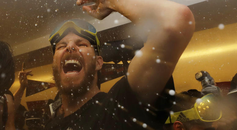 The Boston Red Sox Chris Sale celebrates in the clubhouse after Game 5