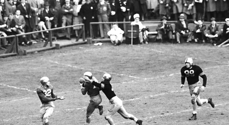 In this Nov. 9, 1946, file photo, Notre Dame's Emil Sitko (14) grabs a pass intended for Army's Bill West,