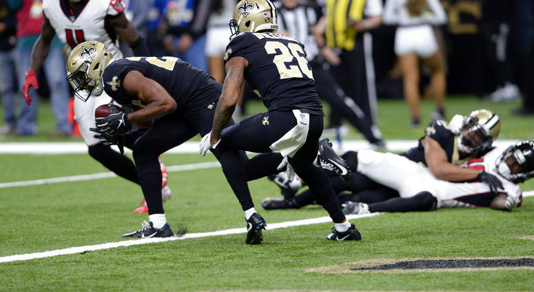 New Orleans Saints cornerback Eli Apple recovers a fumble at their goal line in the second half of an NFL football game against the Atlanta Falcons