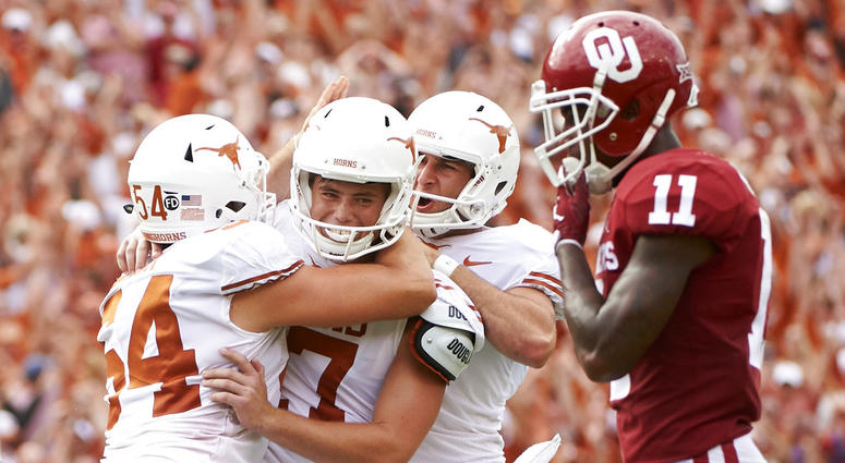 exas kicker Cameron Dicker (17) celebrates with teammates after kicking the game-winning field goal in the closing seconds of the second half of an NCAA college football game against Oklahoma at the Cotton Bowl in Dallas