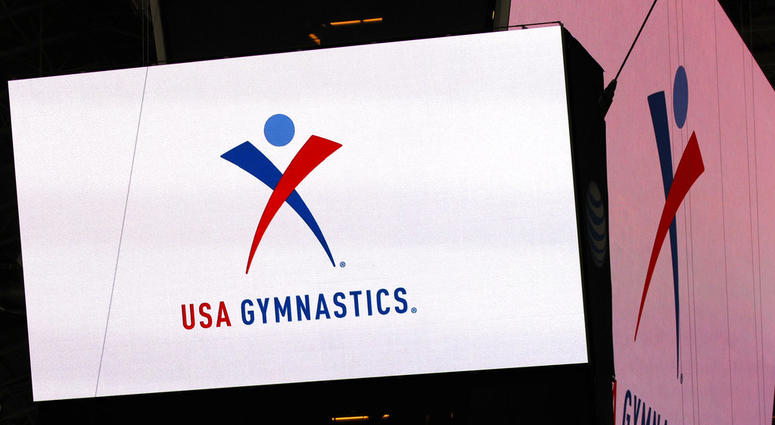 USA Gymnastics logo is displayed at AT&T Stadium