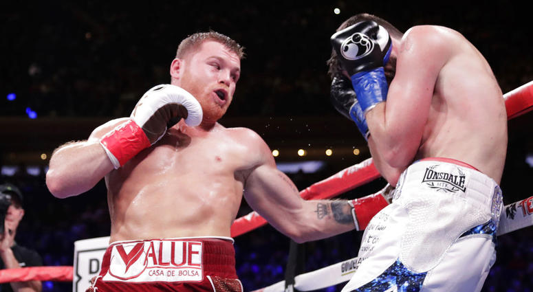 Mexico's Canelo Alvarez, left, punches England's Rocky Fielding during the third round of a WBA super middleweight championship boxing match Saturday, Dec. 15, 2018, in New York.