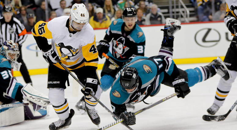 Anaheim Ducks' Ryan Kesler (17) tumbles as he and Pittsburgh Penguins' Zach Aston-Reese