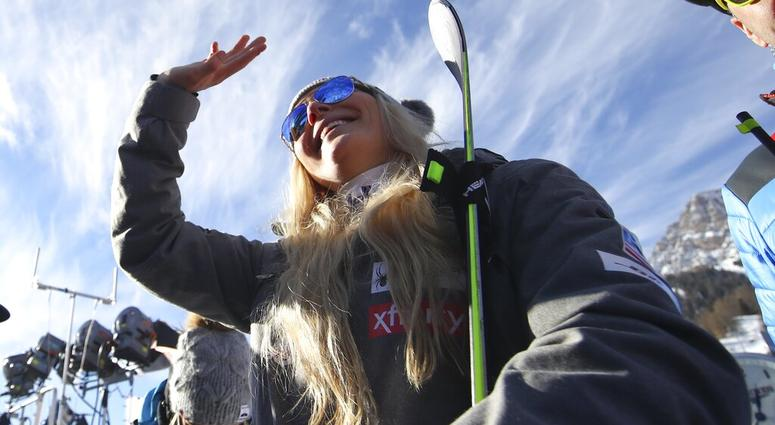 United States' Lindsey Vonn waves as she stands in the finish area after completing an alpine ski, women's World Cup super-G in Cortina D'Ampezzo, Italy, Sunday, Jan. 20, 2019