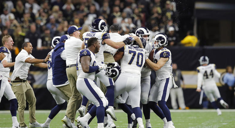 Los Angeles Rams celebrate after overtime of the NFL football NFC championship game against the New Orleans Saints
