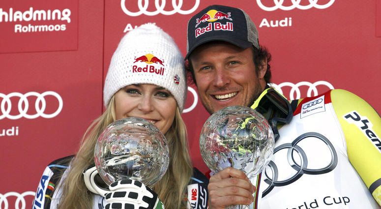 Lindsey Vonn, of the United States, left, and Norway's Aksel Lund Svindal pose with their trophies of the alpine ski, women's and men's World Cup super-G discipline titles, in Schladming, Austria.