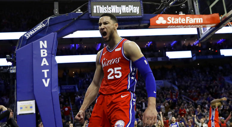 Philadelphia 76ers' Ben Simmons reacts after being fouled during the second half of the team's NBA basketball game against the Denver Nuggets