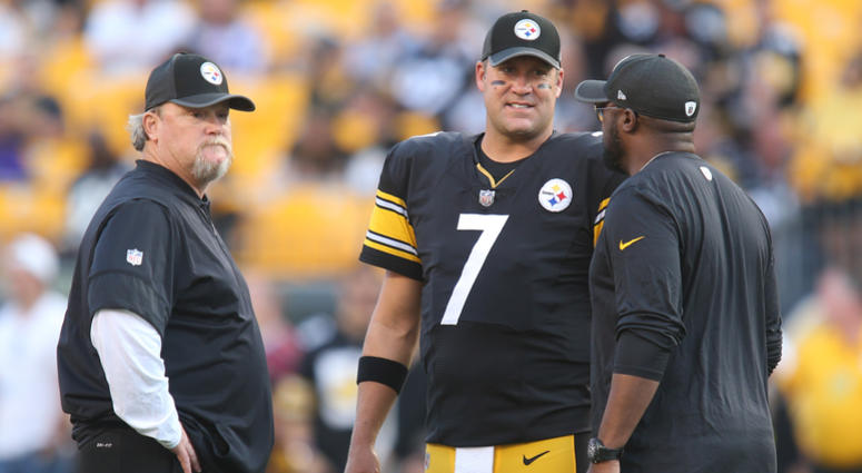 Pittsburgh Steelers quarterback Ben Roethlisberger (7) talks with quarterbacks coach Randy Fichtner (left) and head coach Mike Tomlin (right) before playing the Indianapolis Colts at Heinz Field.