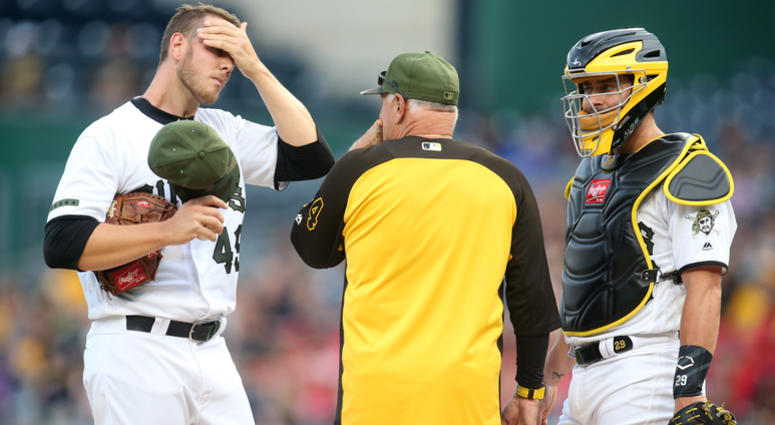 Pittsburgh Pirates starting pitcher Nick Kingham (49) wipes his brow while he listens to pitching coach Ray Searage (middle) as catcher Francisco Cervelli (29) looks on against the New York Mets