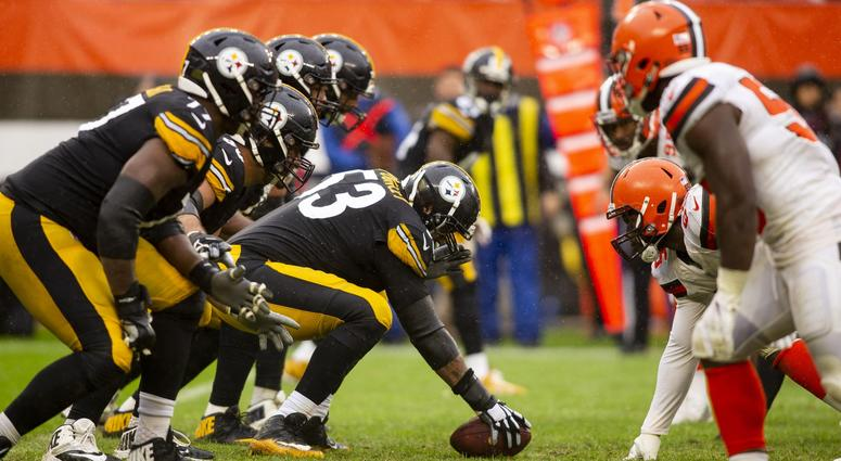 Pittsburgh Steelers center Maurkice Pouncey (53) holds the ball at the line of scrimmage against the Cleveland Browns during the fourth quarter at FirstEnergy Stadium.