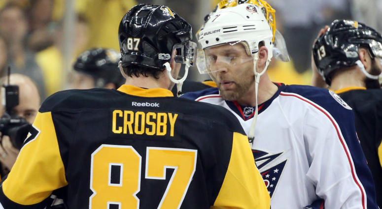 Pittsburgh Penguins center Sidney Crosby (87) and Columbus Blue Jackets defenseman Jack Johnson (7) in the handshake line after game five of the first round of the 2017 Stanley Cup Playoffs at PPG PAINTS ARENA.