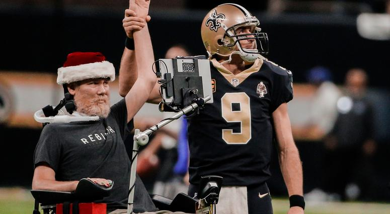 New Orleans Saints quarterback Drew Brees (9) leads the who dat chant with former player Steve Gleason