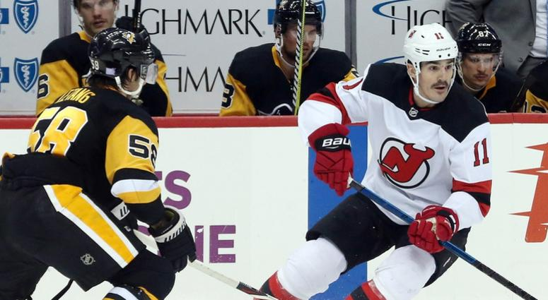 New Jersey Devils center Brian Boyle skates with the puck against Pittsburgh Penguins defenseman Kris Letang