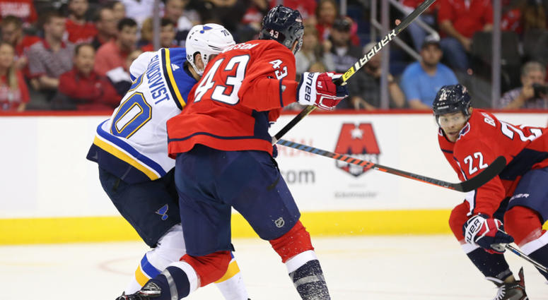 Washington Capitals right wing Tom Wilson (43) checks St. Louis Blues center Oskar Sundqvist (70) in the second period at Capital One Arena.