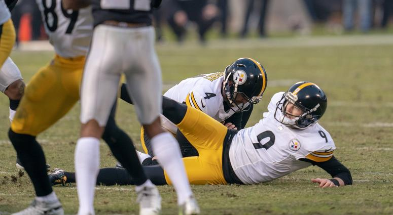 Pittsburgh Steelers kicker Chris Boswell (9) slips during a field goal attempt to tie the game against the Oakland Raiders during the fourth quarter at Oakland Coliseum.