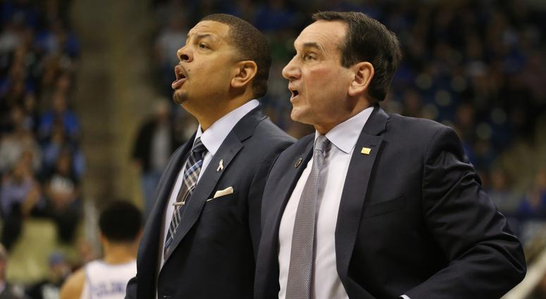 Duke Blue Devils assistant coach Jeff Capel (left) and head coach Mike Krzyzewski (right) react on the bench against the Pittsburgh Panthers during the first half at the Petersen Events Center.