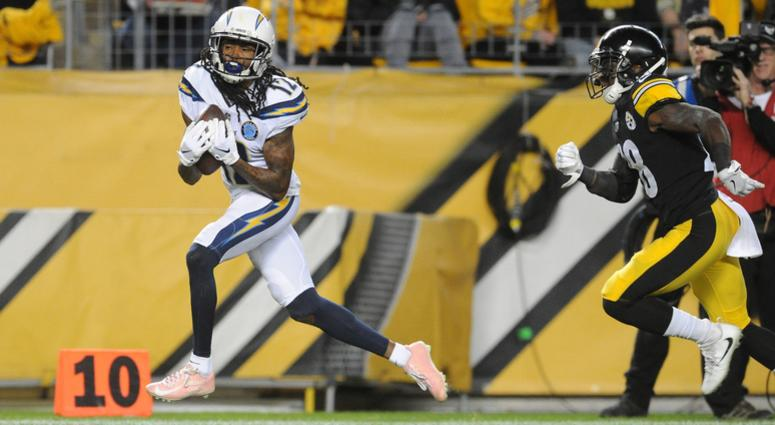 San Diego Chargers wide receiver Travis Benjamin (12) scores a first quarter touchdown by Pittsburgh Steelers cornerback Mike Hilton (28) at Heinz Field.